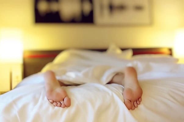 Person lying in bed