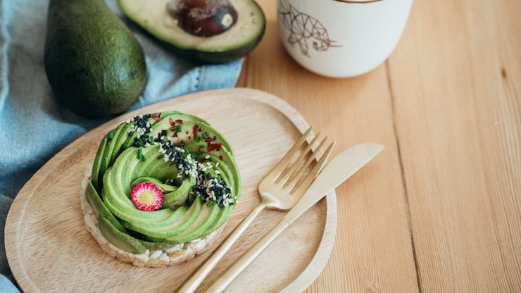 A green and black keto breakfast no eggs on a table