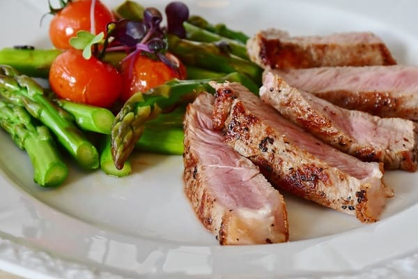 cooked meat and vegetables in a plate