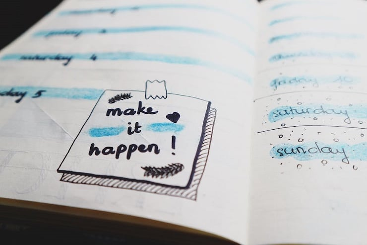 Keto meal plan for beginners symbolised by a motivational note in a diary that says make it happen