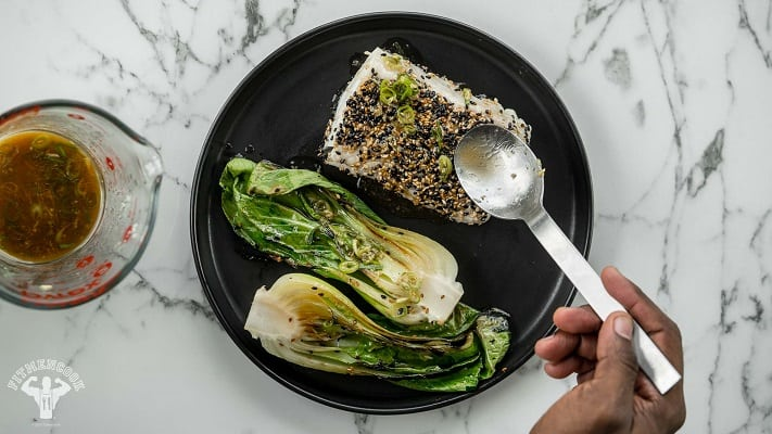 Low carb sesame crusted cod and bok choy on a plate