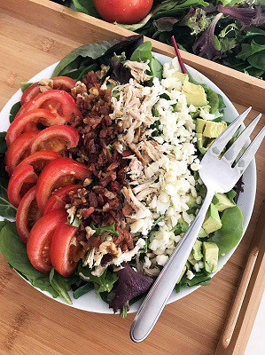 Keto cobb salad on a plate with a fork
