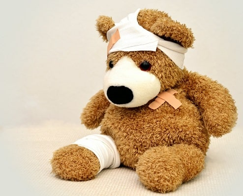 Teddy bear with bandages on it