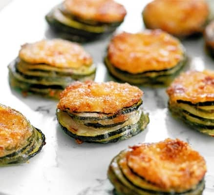 Parmesan zucchini stacks on a silver surface