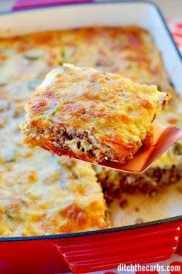 Keto bacon cheeseburger casserole with a piece taken out of the dish