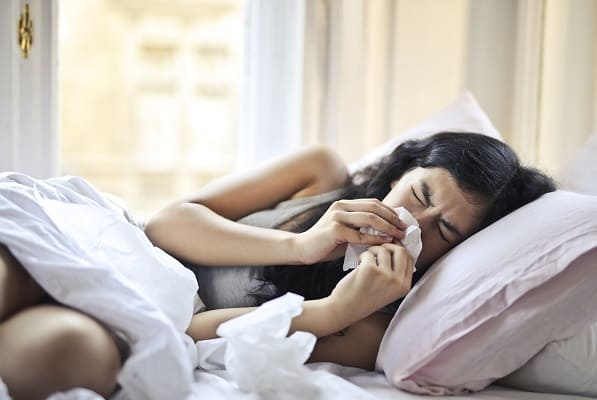 Woman in bed with illness