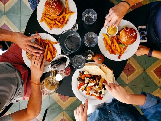 Group of people eating fatty foods