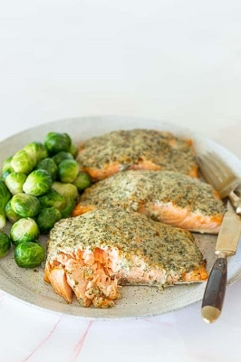 Garlic parmesan keto salmon on a plate with brussel sprouts