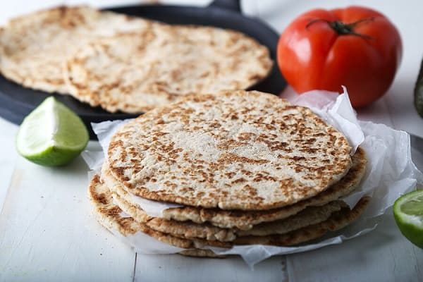 Best low carb tortillas on a plate with vegetables in the background