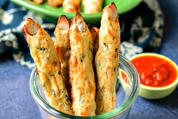 Keto halloween with finger breadsticks in a cup