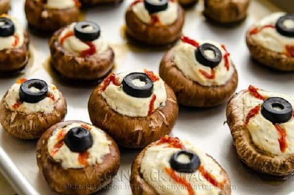 Stuffed eyeball mushrooms on a tray